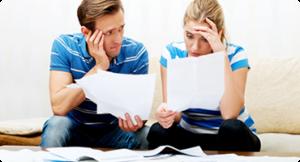 Worried Couple Looking at Bills
